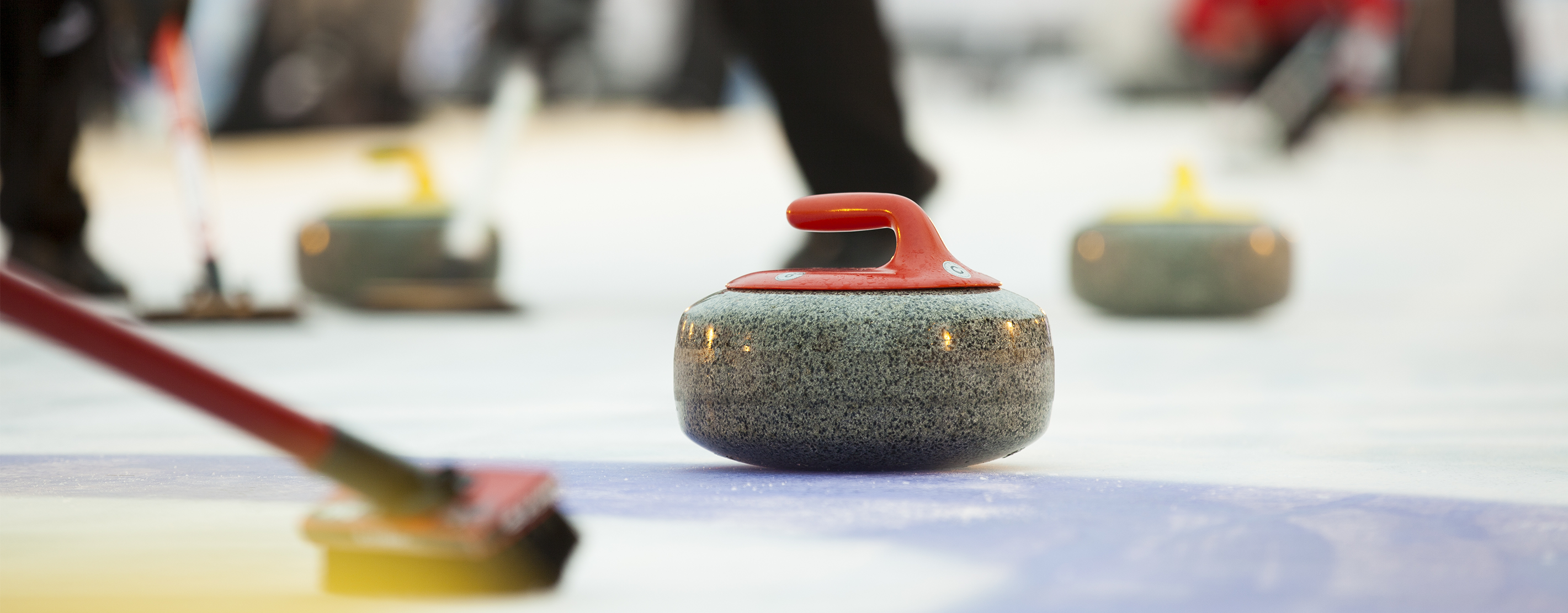 Curling Ice With Curlers Playing