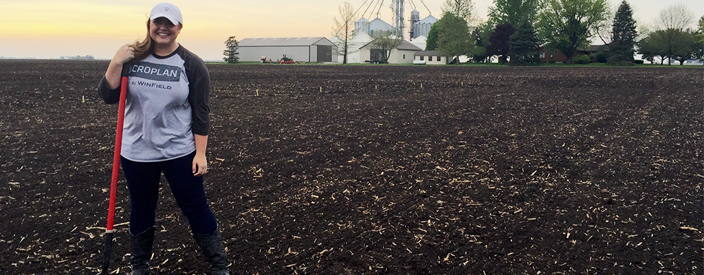 WinField Associate Sara Smelser Stands In A Farm Field